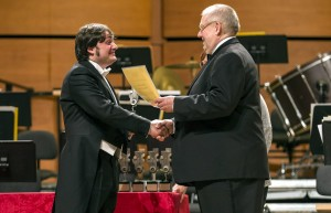Alessandro Mazzamuto receiving the Award Diploma from Jury President Remy Franck