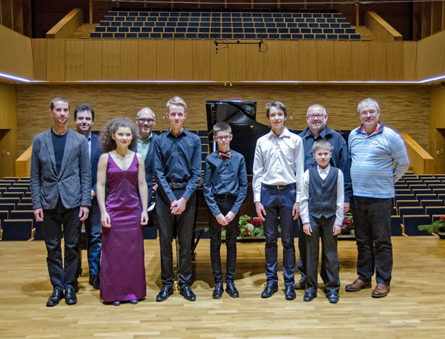 ICMA Jury members and young Polish musicians. From the right: Guy Engels, 12 years-old pianist Bartlomiej Slimak, Remy Franck, violinist Jakub Staszel, cellist Krzysztof Michalski, cellist Michal Balas Violinist, Andrea Meuli, Magdalena Turek, Nicola Catto, and pianist Wojciech Kogut